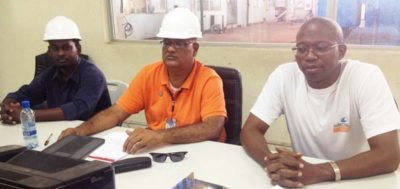 Gobin Harbhajan (c), a Member of the Board of Directors at the Skeldon Energy Inc, with other officials.